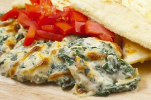 spinach dip with pita bread and peppers